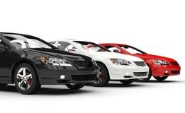 Svart vit och röda snabba bilar Royaltyfri Foto