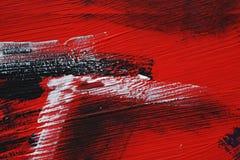 Svart vit, röd akrylmålarfärg på metallyttersida penseldrag arkivbild