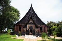 Svart wood hus Arkivbild
