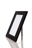 Svart wood ram med reflexion på vit bakgrund Arkivfoton