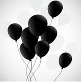 Svarta ballonger på vit bakgrund Arkivbilder