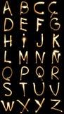 svarta bokstäver för bakgrund Royaltyfri Foto