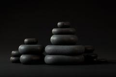 svarta brunnsortstenar Arkivfoto