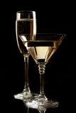 svarta champagneexponeringsglas isolerade martini Royaltyfri Foto
