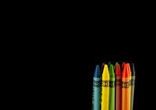svarta crayons royaltyfria bilder