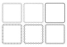 Svarta dekorativa ramar med prydnader - vektor Arkivbilder