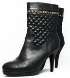 Svarta eleganta hög-heeled kängor Arkivbilder