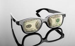 Svarta exponeringsglas med dollar i stället för linser Arkivfoto