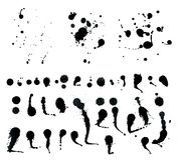 Svarta färgpulversprejdroppar som isoleras på vit bakgrund Royaltyfri Bild