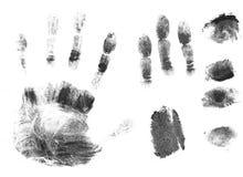 svarta fingertrycksilhouettes Arkivfoto