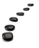 svarta gåstenar Arkivbilder