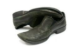 svarta gammala skor Royaltyfria Bilder