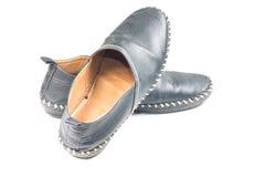 svarta gammala skor Royaltyfri Bild