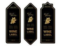 Svarta guld- vinetiketter med druvor på vit bakgrund Rektangelramar på vinflaskan Dekorativa klistermärkear Arkivfoton