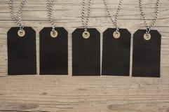 Svarta hängande etiketter Fotografering för Bildbyråer