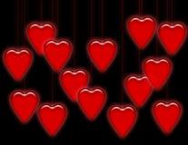 svarta hängande hjärtor Arkivfoto