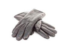 svarta handskar isolerat läder Arkivfoto