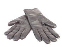 svarta handskar isolerat läder Arkivbilder