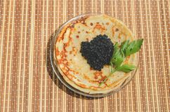svarta kaviarpannkakor Royaltyfri Fotografi
