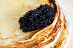 svarta kaviarpannkakor Royaltyfria Bilder