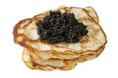 svarta kaviarpannkakor Royaltyfri Foto