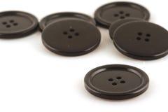 svarta knappar Arkivfoto