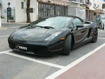 Svarta konvertibla Lamborghini i Puerto Banus Arkivfoto
