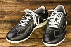 Svarta lädermans sko Fotografering för Bildbyråer
