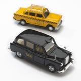 svarta london models nya taxis gula york royaltyfri foto