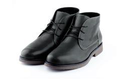 Svarta mäns skor Arkivbild