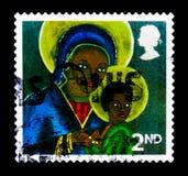 Svarta Madonna och barn från Haiti, jul 2005 - Madonna och Arkivbilder