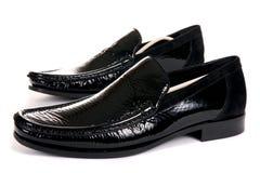svarta male moderna skor Arkivbilder