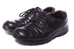 svarta male skor Arkivbilder