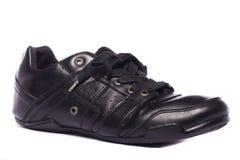 svarta male skor Arkivfoto
