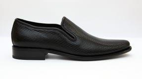 svarta male skor Arkivbild