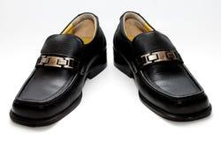 svarta male skor Fotografering för Bildbyråer