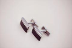 Svarta manschettknappar Fotografering för Bildbyråer