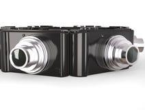 Svarta moderna kompakta digitala fotokameror med silverlinsen Arkivbild
