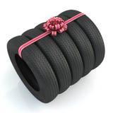 Svarta nya gummihjul med rosa färgpilbågen 3d Fotografering för Bildbyråer