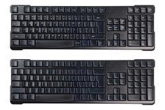 Svarta plast- trådlösa datortangentbord med symboler och utan isolerat på vit bakgrund arkivbilder