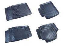 Svarta rubber bilmats som isoleras på en vit bakgrund Arkivbilder
