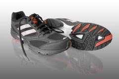 svarta running skor Arkivfoto