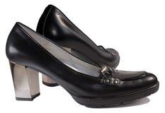 svarta säsongsbetonade skor arkivbild