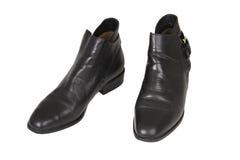 svarta skor Arkivfoto