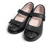 svarta skor för flickalädershine Arkivfoto