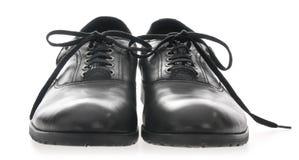 svarta skor för lädermän s Arkivbild