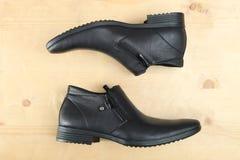 Svarta skor för läderman` s Royaltyfria Foton