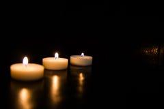 svarta stearinljus för bakgrund Arkivbilder