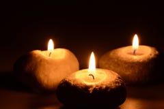 svarta stearinljus tre för bakgrund Arkivfoto