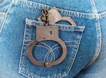 Svarta stålhandbojor i jeansfack Arkivfoton